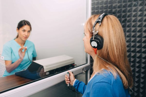 Woman receiving a hearing test from an audiologist